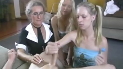 Mom teaching to do a hand job to her daughters