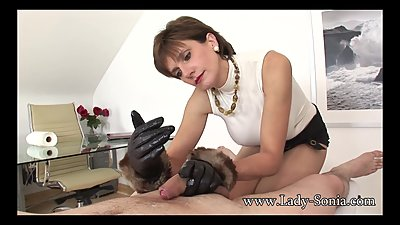 Lady Sonia jerks off twitter fan with leather gloves on