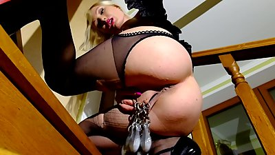 Blonde in high heels, stretches pussy with piercings
