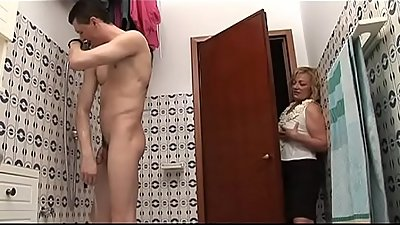 Naughty mom spies her son on the shower
