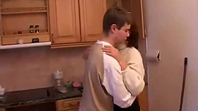 Stepmom and stepson have a sex on the kitchen